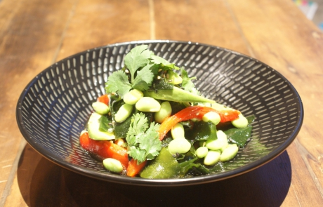 Avocado and wakame seaweed salad with roasted peppers, edamame, coriander, sesame ginger dressing