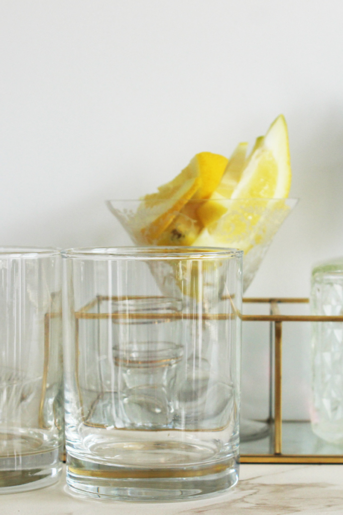 Cocktail glasses garnished with lemon- At Your Table