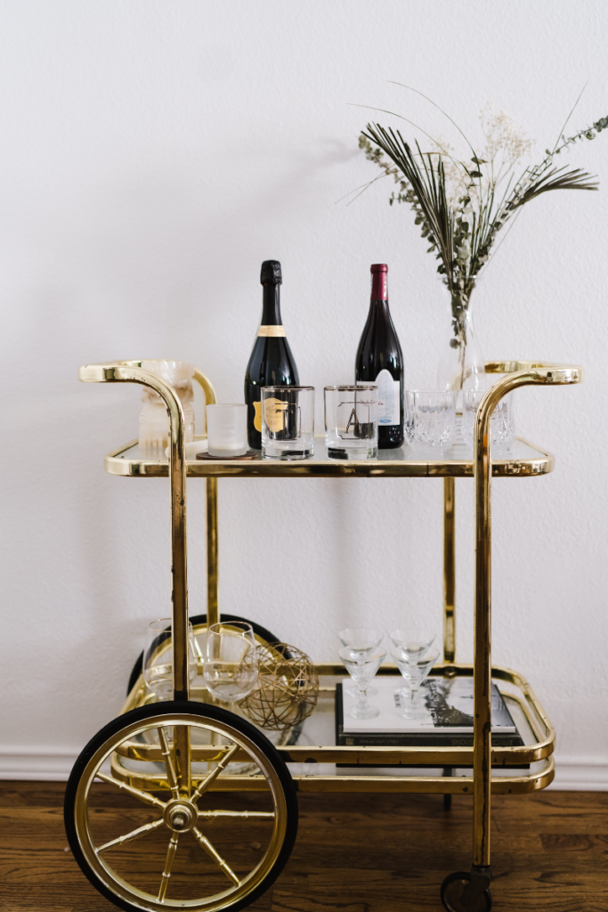Gold bar cart with champagne bottles