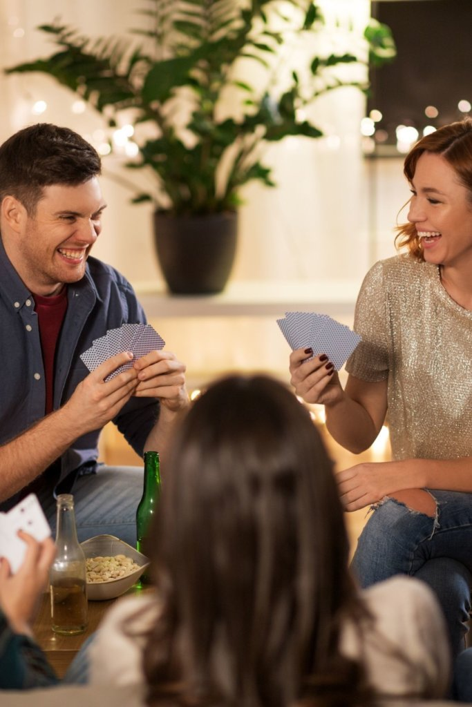 Dinner party game ideas couple playing cards